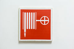 Fire hose symbol Stock Images