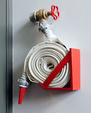 Fire-hose on the wall. In a modern building Royalty Free Stock Photos