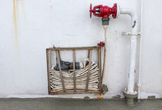 Fire Hose on Wall Royalty Free Stock Photo