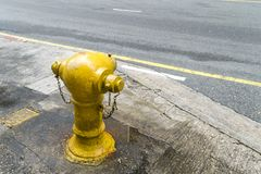 Fire hose water outlet red brick wall Royalty Free Stock Images