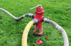 Fire hoses and hydrant. Hydrant furnishing water to 3 hoses during a fire Royalty Free Stock Images