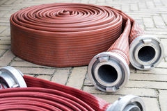 Fire hoses Stock Images