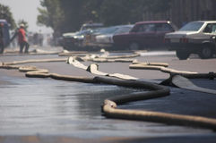 Fire hoses stretching Stock Images