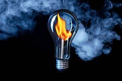 Fire hot idea to save electricity and ecology Royalty Free Stock Image