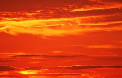 Fire hot sunset. Sunset and clouds with bright orange relflection royalty free stock photo