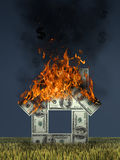 Fire house of hundred-dollar bills. Fire house of hundred-dollar bills on grass field background Stock Photos