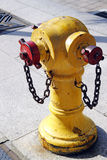 Fire hydrant. An image of a yellow coloured fire hydrant stock image