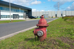 Fire hydrant. Red fire hydrant on an industrial area Royalty Free Stock Images