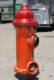 Fire Hydrant. Red fire hydrant in the city Stock Photo