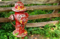 Fire Hydrant. Against wooden fence royalty free stock images
