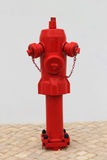Fire hydrant. In a street with a white wall Stock Photography