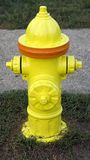 Fire Hydrant. With orange stripe outdoors Royalty Free Stock Photos