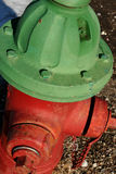 Fire Hydrant. Red and green painted fire hydrant royalty free stock photography