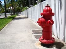 Fire Hydrant. Red Fire Hydrant on Quiet Street Royalty Free Stock Image