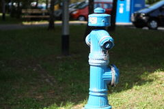 Fire hydrant. Blue fire hydrant on the street stock images