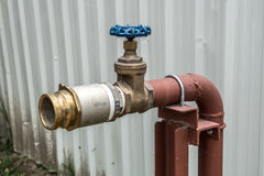 Fire hydrant with blue valve Royalty Free Stock Photography