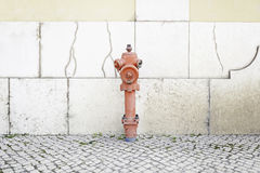 Fire hydrant in a city. Detail of an item to put out fires, real protection and safety Royalty Free Stock Photo