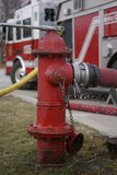 Fire Hydrant and Fire Truck. Fire Hydrant with Shallow Depth of Field firetruck in the background with water stock photography