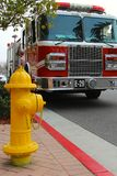 Fire hydrant and fire truck Stock Images