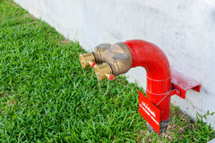 Fire hydrant manifold two outlet water valve. Royalty Free Stock Photo