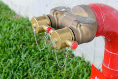 Fire hydrant manifold two outlet water valve. Royalty Free Stock Images