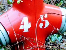 Fire hydrant nr 45. Red. stock photo