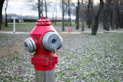 Fire hydrant in nature by the river.  Royalty Free Stock Photos