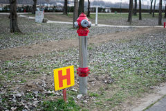 Fire hydrant in nature by the river.  Royalty Free Stock Photography