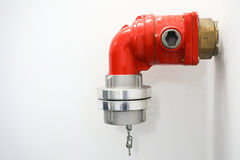 Fire hydrant point. Red fire hydrant point at a building Royalty Free Stock Photography