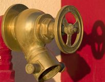 Fire hydrant. On the red background. Egypt Royalty Free Stock Image