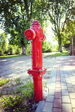 Fire hydrant. Red fire hydrant on beautiful street Stock Image