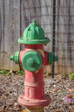 Fire hydrant. Red and green fire hydrant Stock Image