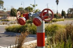 Fire hydrant in red and grey colour royalty free stock photo