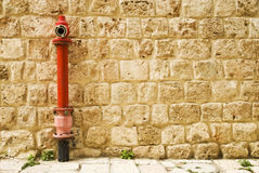Fire hydrant. Red fire hydrant in the wall Royalty Free Stock Photography
