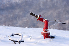 Fire hydrant in the snowy helipad, Italy. Royalty Free Stock Photo