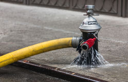 Fire hydrant on the streets of Manhattan. NEW YORK, USA - May 02, 2016: Fire hydrant on streets of Manhattan. Fire Department of NYC provides fire protection Royalty Free Stock Image