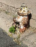 Fire hydrant. Vintage fire hydrant along crumbling sidewalk Royalty Free Stock Photography