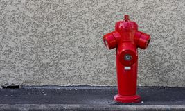 Fire hydrant on the wall. Background Stock Photo