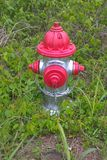 Fire Hydrants. Known as NFPA 291, it says fire hydrants using public water supply systems should be painted chrome yellow and their tops and caps should indicate Stock Image