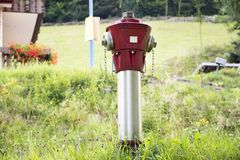Fire hydrants with water hoses and fire extinguish equipment. Connections outside at outdoor in countryside of Germany Stock Photos