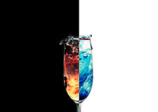 Fire and Ice. A dual photo of a splashing glass Royalty Free Stock Photos