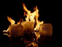 Fire & Ice. Burning Icecubes on black surface Stock Photo