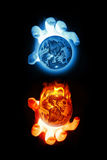 Fire & Ice hands over globes Stock Photography