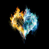Fire-ice heart. Burning heart on the black background Royalty Free Stock Image