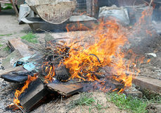 Fire illegal burn litter Stock Photo