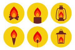 Fire illuminating devices icon set. Vector icon set: campfire, candle, oil lamp, torch, match and lantern in red and yellow tones Royalty Free Stock Photo