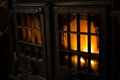 By The Fire. An image showing a wood burning stove in a Welsh farmhouse Royalty Free Stock Image