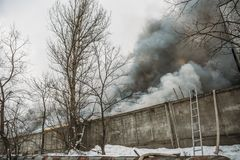 Fire in an industrial warehouse or Factory, lots of smoke and flames Stock Images