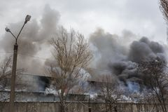 Fire in an industrial warehouse or Factory, lots of smoke and flames Stock Photos