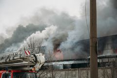 Fire in an industrial warehouse or Factory, lots of smoke and flames Stock Image